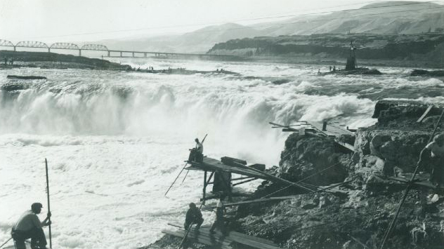 Native Americans fishing at Celilo Falls, circa 1940. Found vernacular photograph